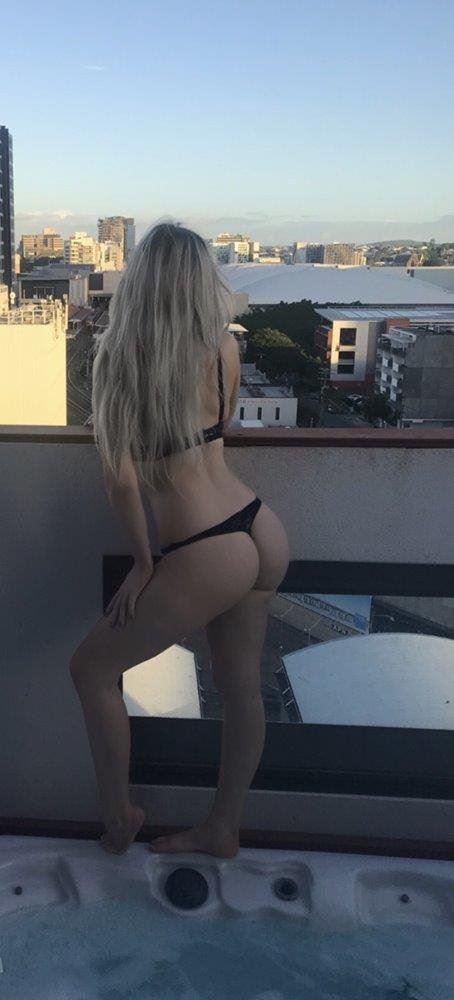 Sensual blonde offering body rubs