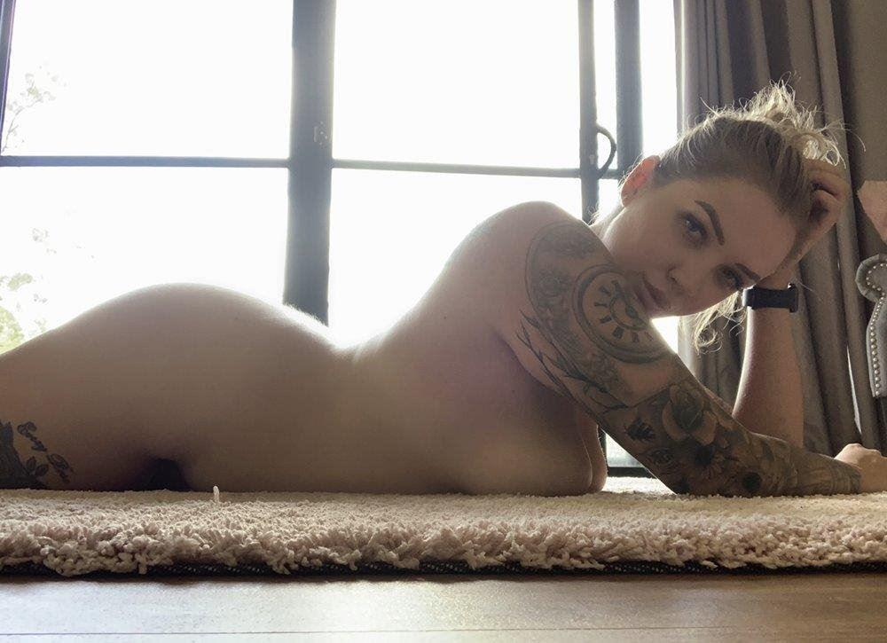 Tall, curvy, tattooed & natural blue eyed blonde